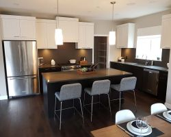White upper cabinetry and dark lower cabinets in Squamish Showhome