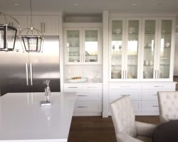 white custom kitchen cabinets with glass insets