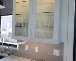 glass cabinet doors in white cabinetry